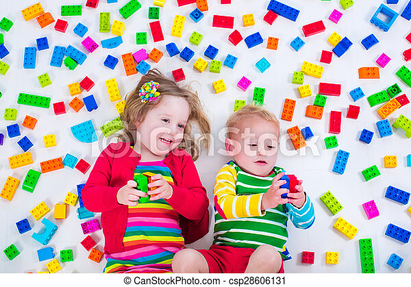 Kids playing with colorful blocks - csp28606131