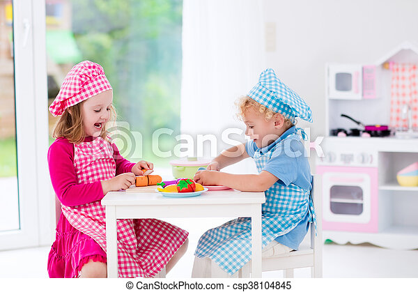 Kids playing with toy kitchen - csp38104845