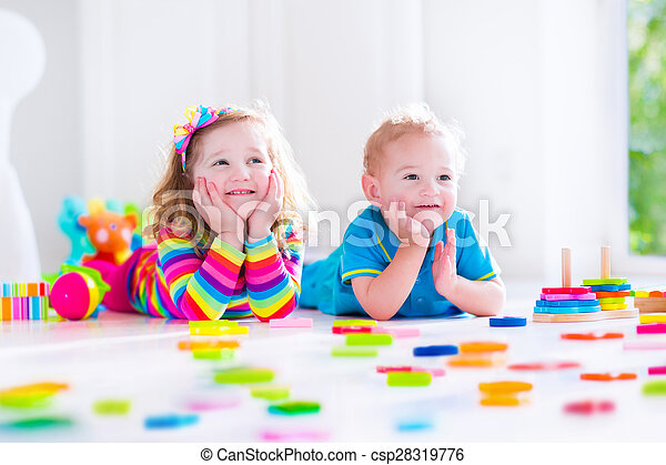 Kids playing with wooden blocks - csp28319776