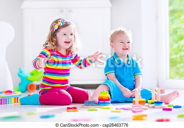 Kids playing with wooden blocks - csp28463776
