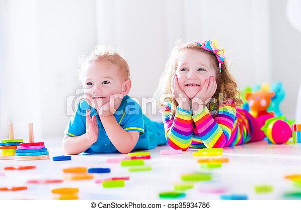 Kids playing with wooden blocks - csp35934786
