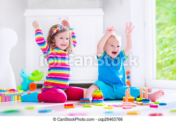 Kids playing with wooden blocks - csp28463766