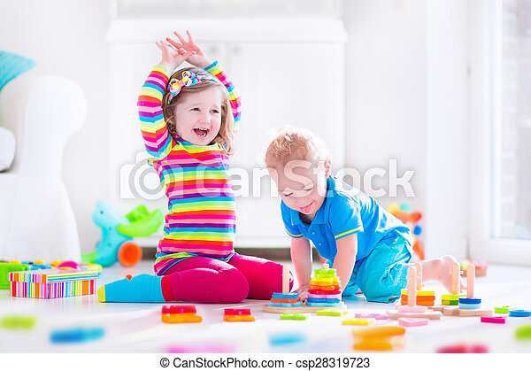 Kids playing with wooden blocks - csp28319723