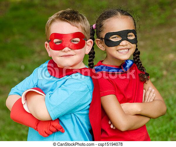 Kids pretending to be superheroes - csp15194078