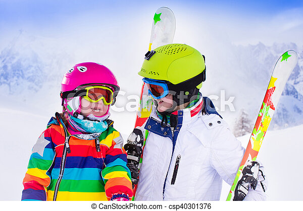 Kids skiing in the mountains - csp40301376