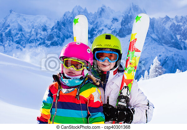 Kids skiing in the mountains - csp40301368