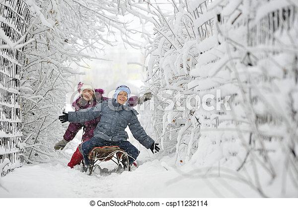Kids sliding in winter time - csp11232114