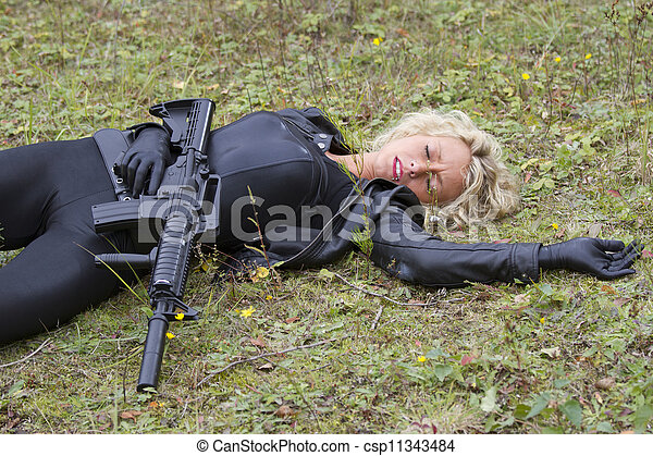 Killed or shot down. Woman playing dead scene with machine ...