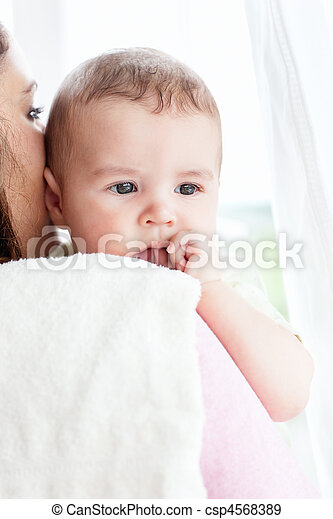 Kind caucasian mother taking care of her adorable baby - csp4568389