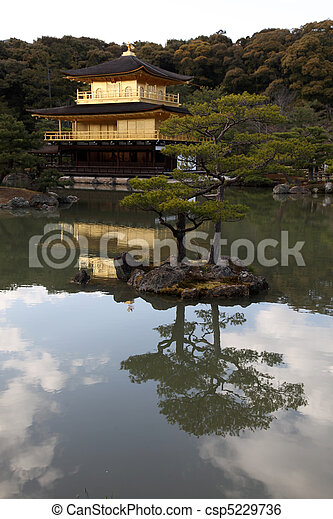 Kinkakuji - The famous Golden Temple from Kyoto, Japan.   Construction of the original building was commenced in 1397 initially as the house of a retired Shogun and later converted into a Zen temple - csp5229736