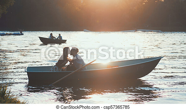 Kissing couple in a boat - csp57365785