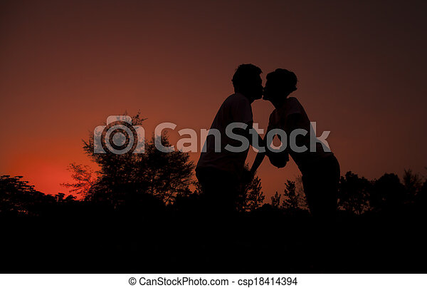 Kissing couple over evening  - csp18414394