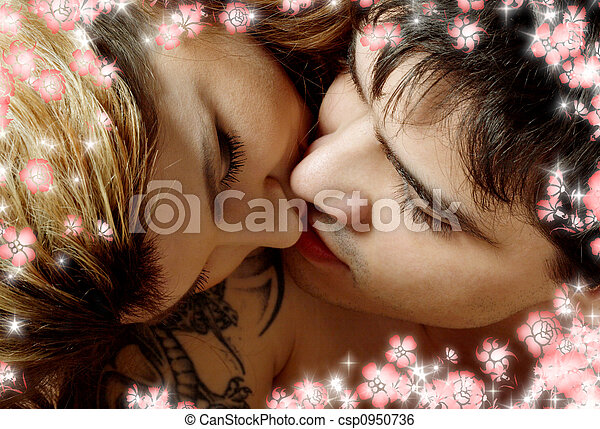 kissing in bed with flowers - csp0950736