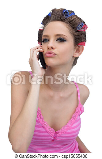 Kissing model wearing hair rollers with phone - csp15655406
