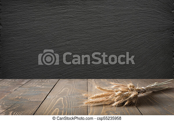 Kitchen Abstract Background Wooden Tabletop With Ears Of Wheat And Black Slate Chalkboard For Display
