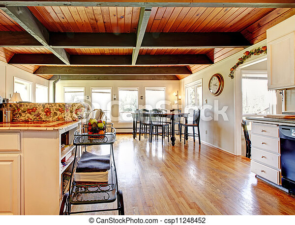 Kitchen and dining room area with wood ceiling. - csp11248452