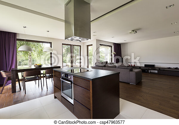 Kitchen island in center of open home space - csp47963577