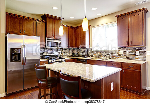 Kitchen mahogany storage combination with steel kitchen appliances and back splash trim - csp38378647