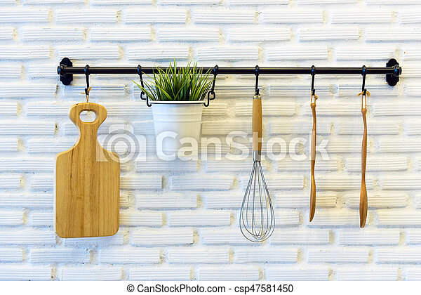 Kitchen Tools hang on the white brick wall