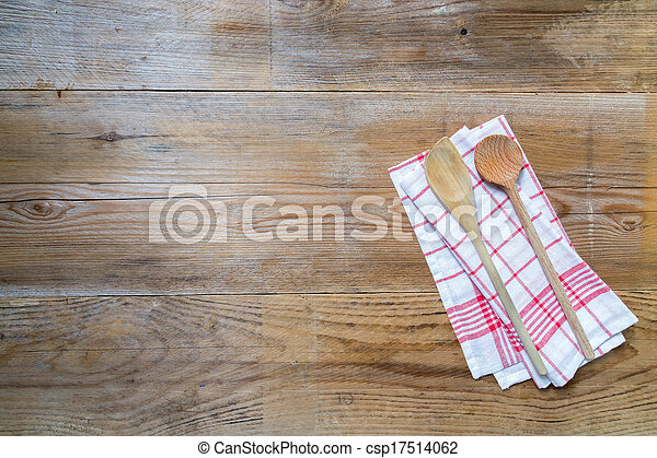 Kitchen towel background with wooden spoons - csp17514062