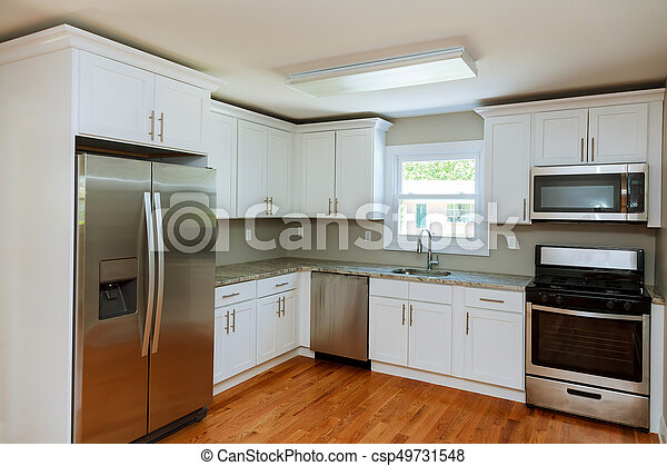 kitchen with appliances and a beautiful interior - csp49731548