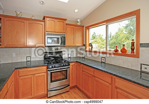 Kitchen with cherry cabinets - csp4999047