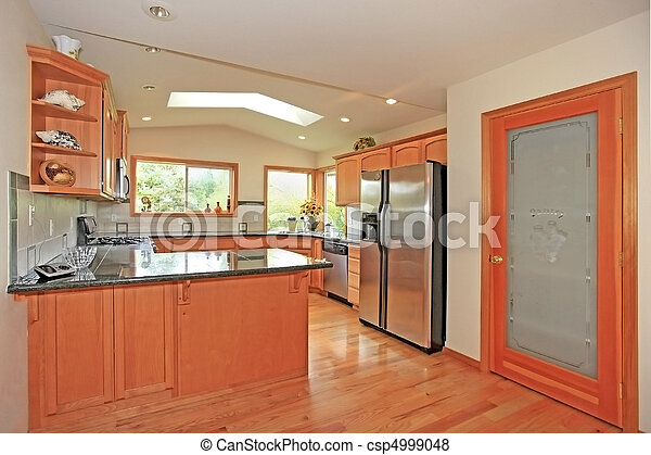 Kitchen with cherry cabinets - csp4999048