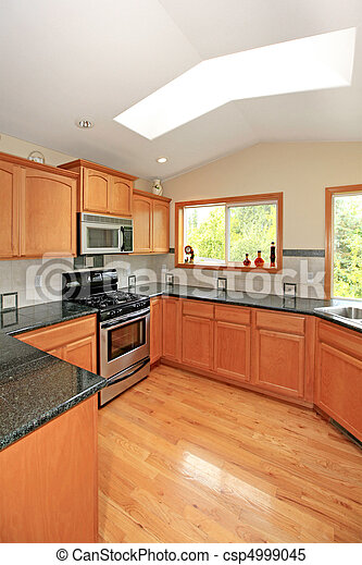 Kitchen with cherry cabinets - csp4999045
