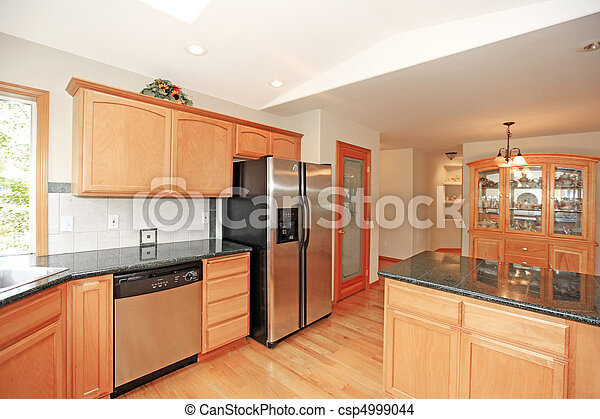 Kitchen with cherry cabinets - csp4999044