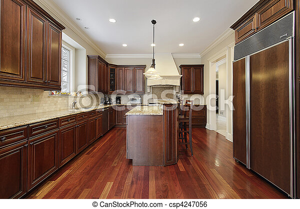 Kitchen with cherry wood cabinetry - csp4247056