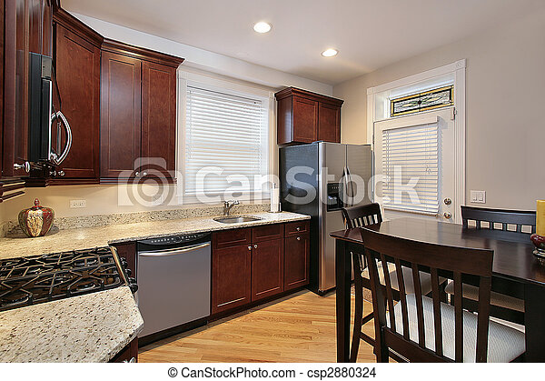 Kitchen with cherry wood cabinetry - csp2880324
