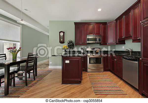 Kitchen with cherry wood cabinetry - csp3055854