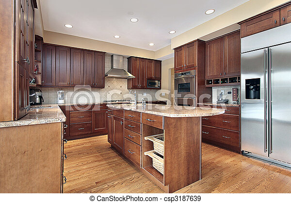 Kitchen with cherry wood cabinetry - csp3187639