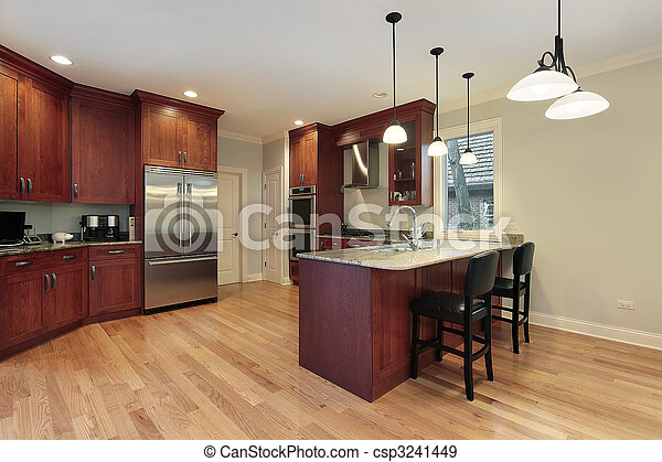 Kitchen with cherry wood cabinetry - csp3241449