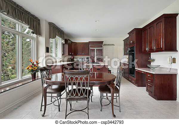 Kitchen with cherry wood cabinetry - csp3442793