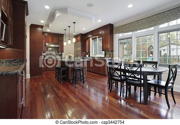 Kitchen with cherry wood flooring - csp3442754