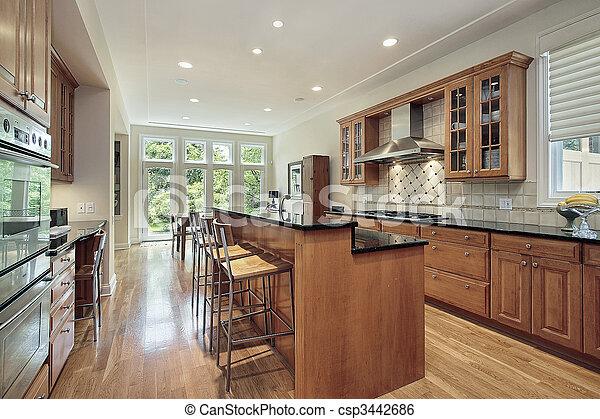 Kitchen with double deck island - csp3442686