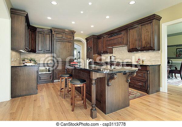 Kitchen with granite island top - csp3113778