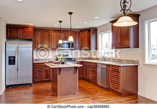 Kitchen with hardwood floor and granite counter tops. - csp38496880