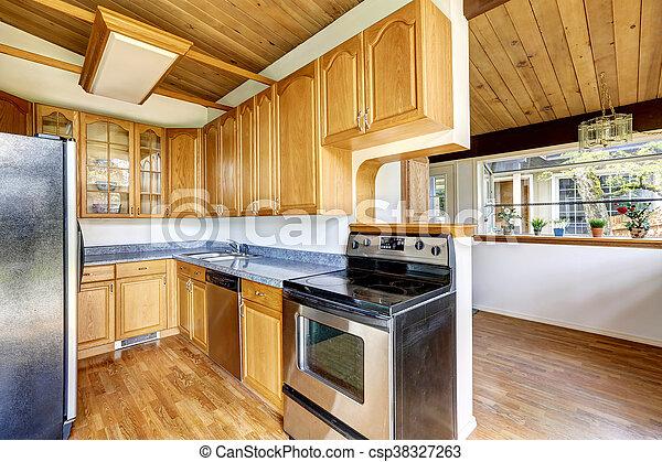 Kitchen  with hardwood floor and granite counter top - csp38327263