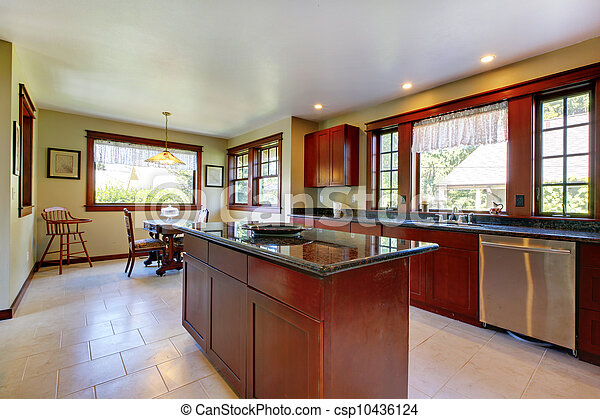 Kitchen with island and dark wood floor. - csp10436124