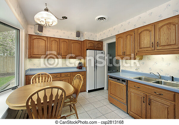 Kitchen with wood cabinetry - csp2813168