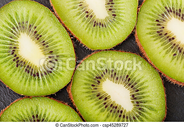 Kiwi fruit on a dark background, food. - csp45289727