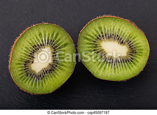 Kiwi fruit on a dark background - csp45097197