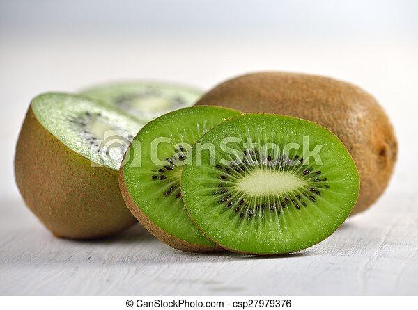 Kiwi fruit on white wooden background - csp27979376