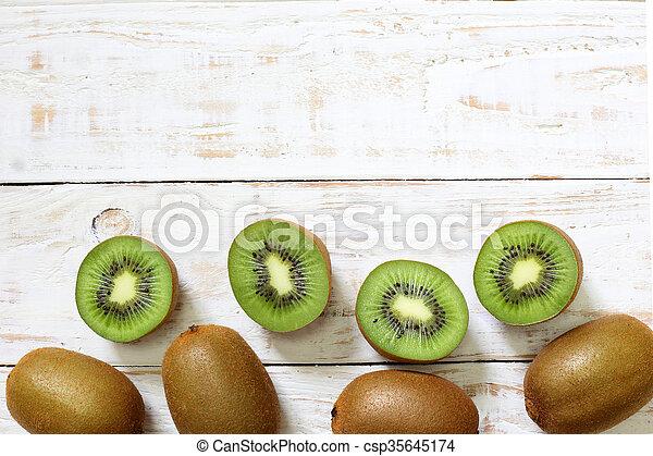 Kiwi fruit on white wooden background - csp35645174