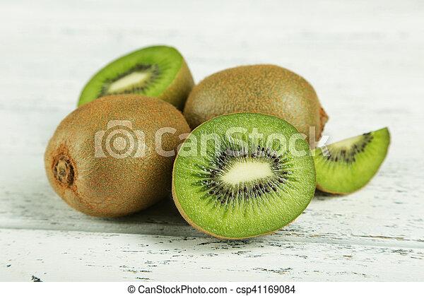 Kiwi fruit on white wooden background - csp41169084