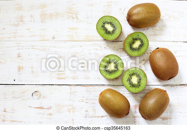 Kiwi fruit on white wooden background - csp35645163
