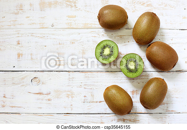 Kiwi fruit on white wooden background - csp35645155