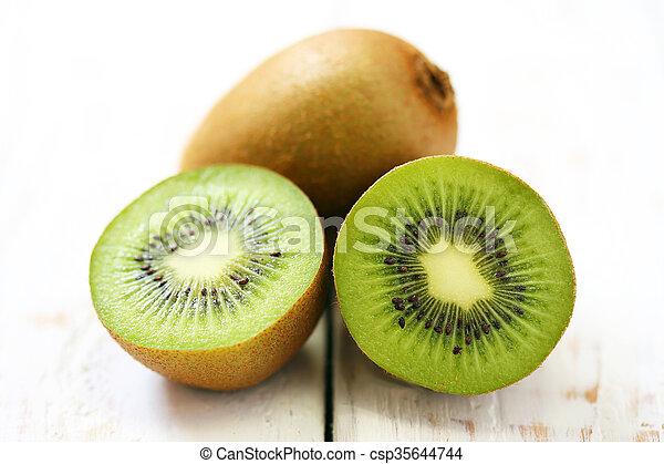 Kiwi fruit on white wooden background - csp35644744